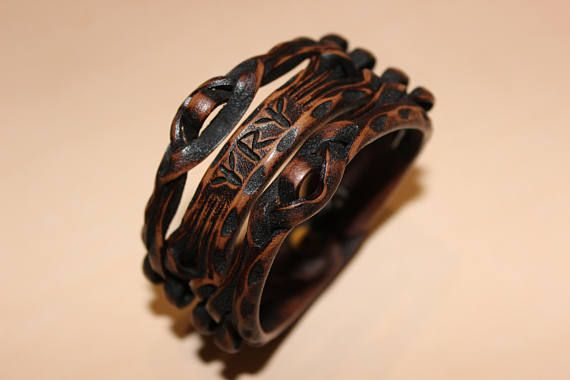 Braided leather bracelet with runic formula. A guardian on the