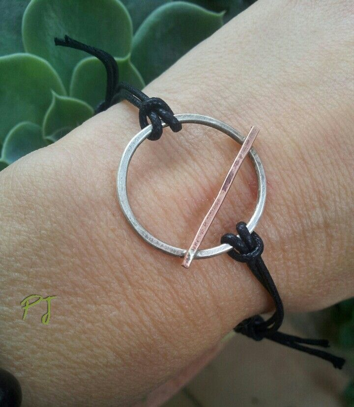 ManWoman, a man is.the line and the woman a circle, silver.and copper bracelet, by PadmaJewels