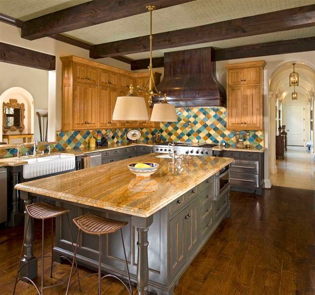 Colorful Kitchen With Large Island And Hand Scraped Would