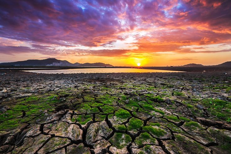 Cracked Sunset - Beautiful sunset at Bang Phra reservoir, Thailand.  The water level is critically low due to much less rain than usual.
