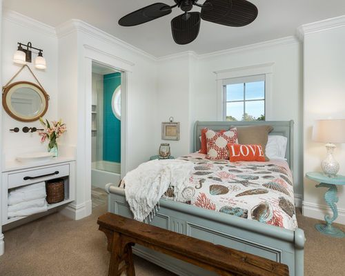 Coastal master bedroom photo in Miami with white walls, carpet and brown floors