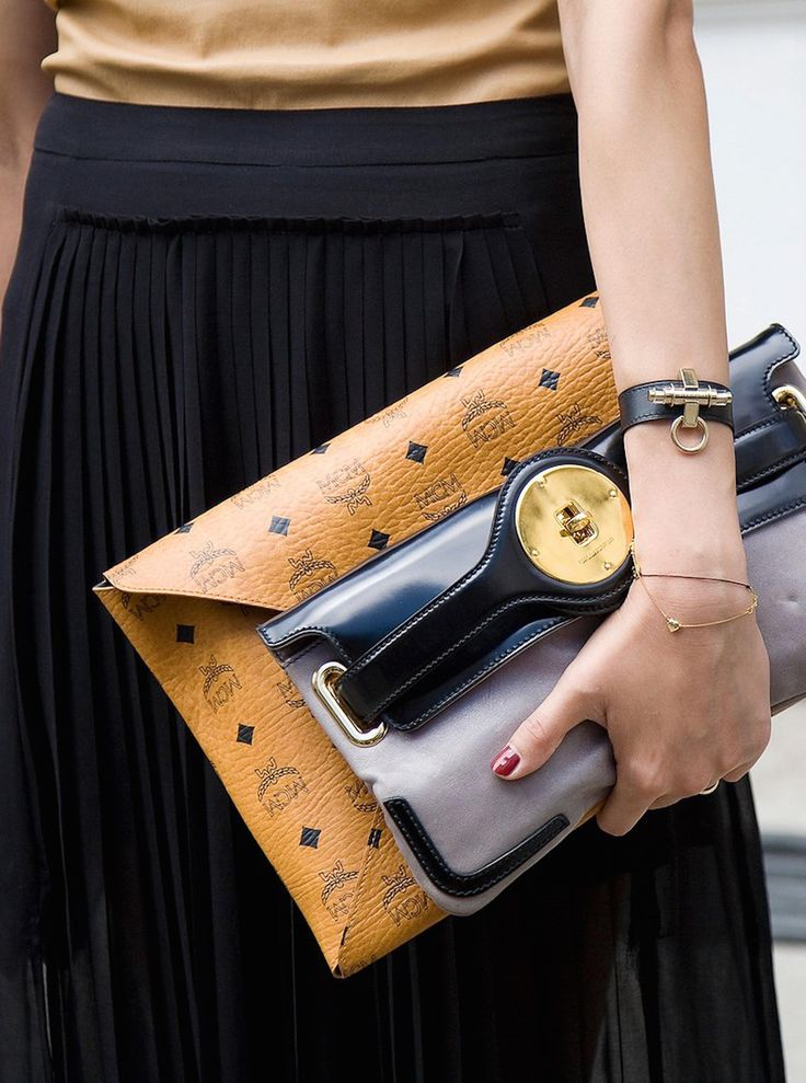 Gold top, black pleated skirt, MCM clutch