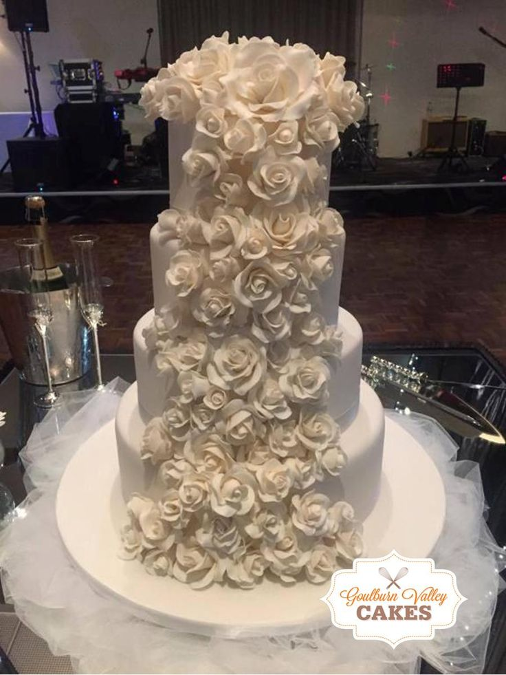 4 Tier Wedding Cake with hand made roses