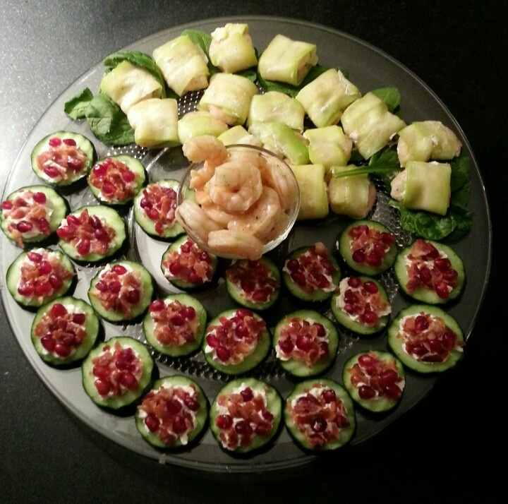 "New Year's Eve ~ appetizers [Cucumbers cut in 1/8 inch rounds with waffle wave cutter, topped with [low fat? or reg] cream cheese from a ""star"" cookie press tip, top with cooked crumbled slab pork bacon & pomegranate seeds, serve cold.]  Shrimp recipe continued on next ""comment""!"