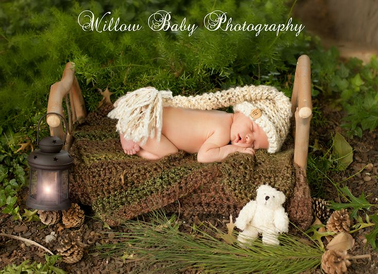 Newborn photography - wood bed outside with newborn baby boy - Willow Baby Photography