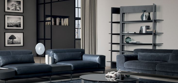This hybrid wall unit is inspired by the screens of the 19th century. The designers have used this classic design to create a modern furniture piece that merges the past with present and creates an elegant yet thoroughly practical item.  #ItalianDesignerLivingRoom #LuxuryBookshelf