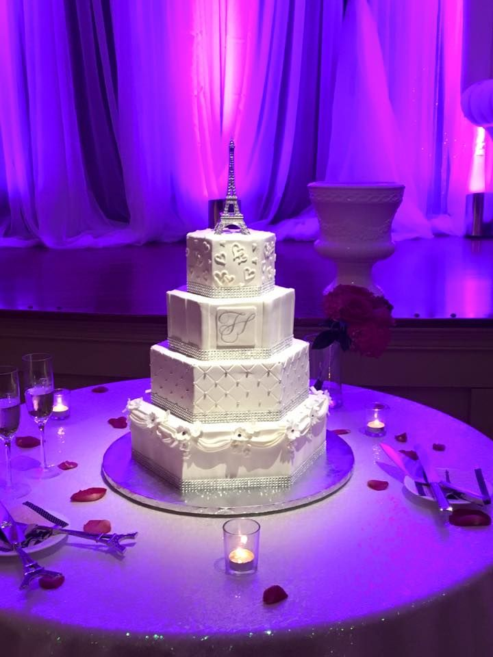 Silver and white hexagon wedding cake by Cindy's Cakery // drapes, gumpaste flowers, monogram, silver dragees, Eiffel Tower topper // David Schwartz Photography // Wedding Co of Williamsburg // Colonial Heritage Country Club // Stage Right Lighting //