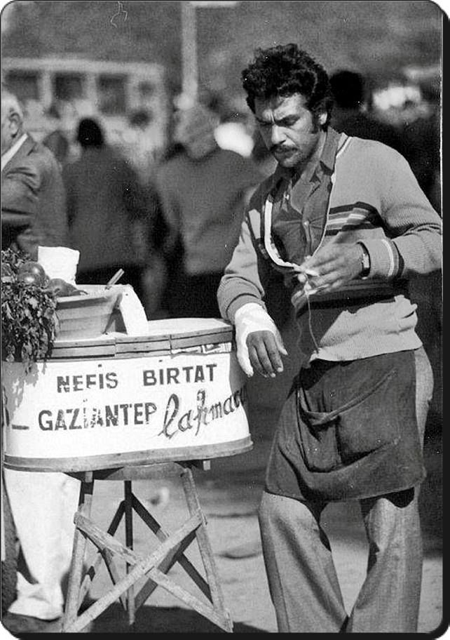 STREET SELLER - 'Lahmacuncu', selling 'lahmacun', a kind of Turkish/Anatolian pizza, for which Gaziantep is famous. 1970s.