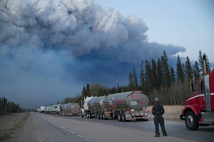 Drivers wait for clearance to take firefighting supplies into town on May 05, 2016 outside of Fort McMurray.