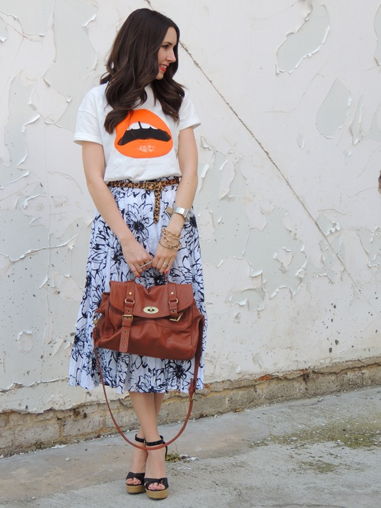 graphic tee + floral skirt... really unique styling.. she even threw in an animal print belt !
