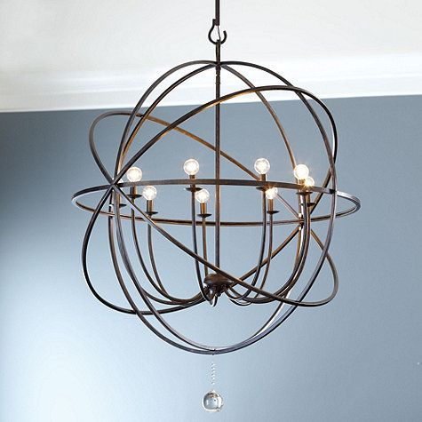 This grand chandelier features an openwork sphere of hand wrought iron surrounding nine upright globe lights to illuminate your space. A…