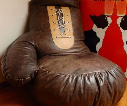 Butch up any room in your home by accenting it with the comfy boxing glove bean bag chair. Styled like an old-school leather boxing glove, this ginormous bean bag makes the perfect place for any boxing enthusiast to relax and unwind after a rigorous sparring session.