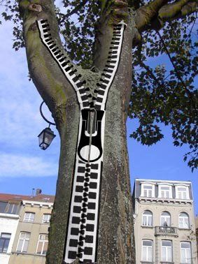 """French artist Benoit Lemoine has created """"zipper tape"""" which allows him to add zippers to objects in public places. Just trying to tidy things up.... :)"""