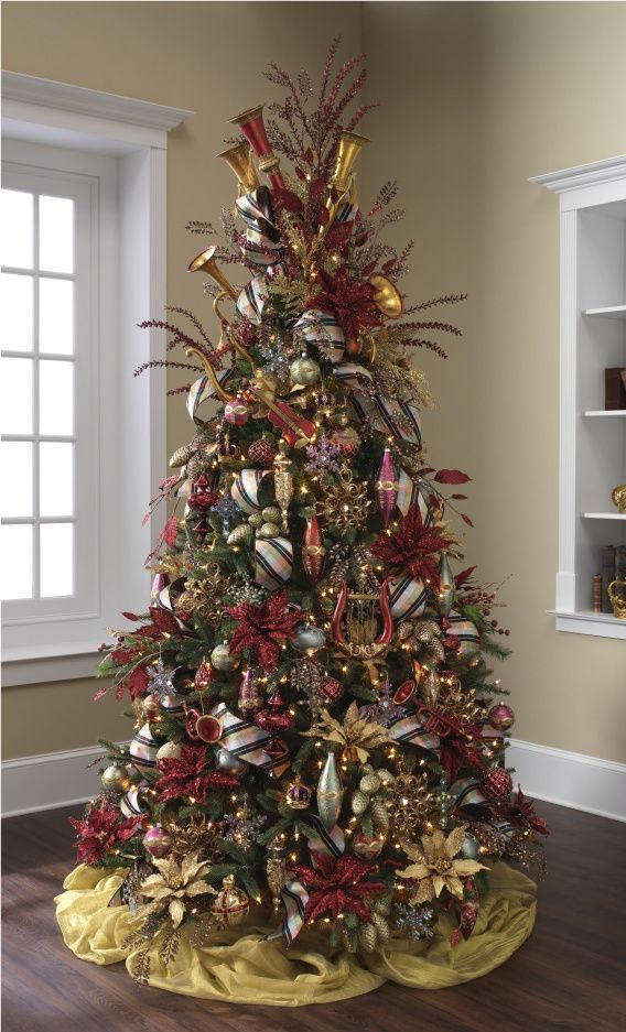 brown and blue christmas tree ideas | Renaissance Reverly Decorated Tree filled with crowns, crosses ...