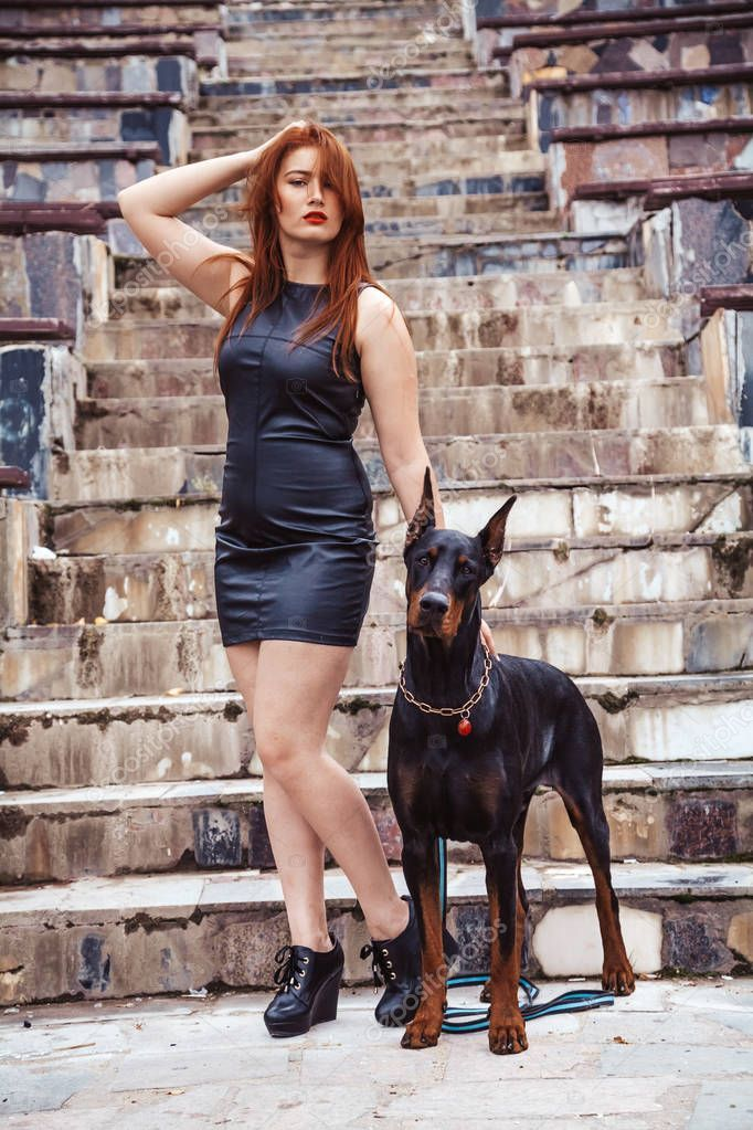 Beautiful Woman Owner With Her Dog Black Doberman Outdoor Walking