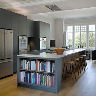 Like the the presses above the open countertop space are set back and continue to the roof