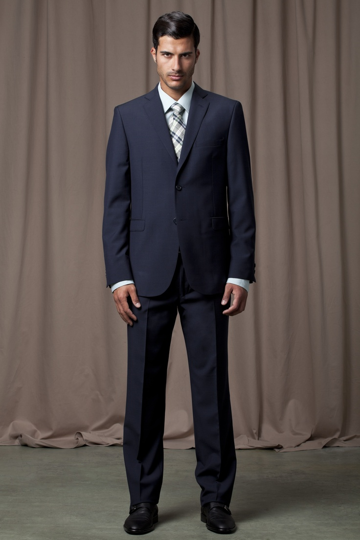 Navy blue suit, power blue shirt and blue checked tie