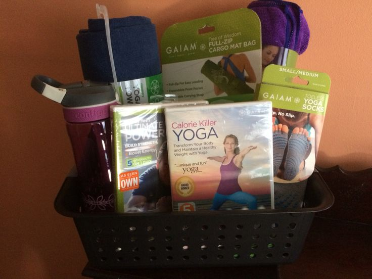 Yoga gift / raffle basket!  Contents:  Yoga DVDs Yoga mats Water bottle  Toeless yoga socks Canvas mat carrying bag