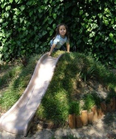 Create a mound for them to climb up and slide down. One skip less building rubble to the skip!