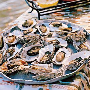 Grilled oysters. Grilling oysters over high heat saves you the trouble of shucking them first, since the intense heat forces the shells open on their own.