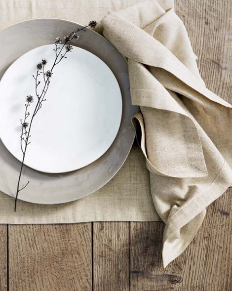 I love the neutral colours and the linen texture against the rough wood. Simple, understated, and gorgeous.