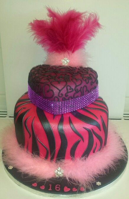 My own design. Zebra print, bling and feathers cake.