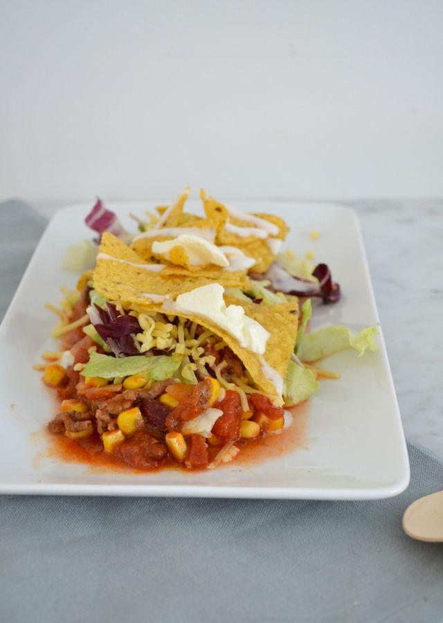 Een variant op de beruchte Kapsalon is deze Mexicaanse kapsalon met tortillachips en kaas.