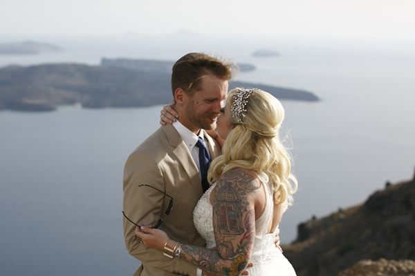 the perfect first look with the Aegean at the backdrop   summer Santorini wedding