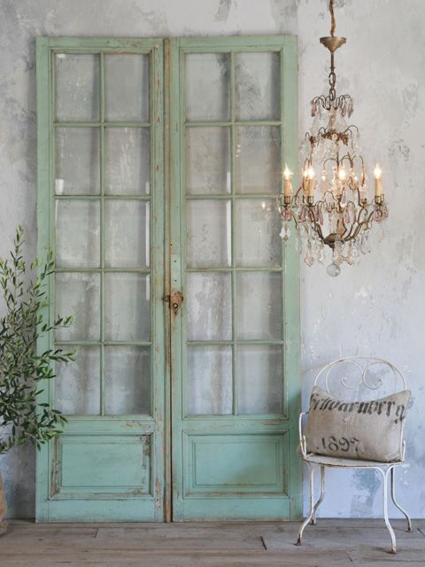 Classic old panelled shop entry doors each with 10 bevelled glass windows. Original spearmint green finish reminiscent of a pharmacy or sweet shop! Circa 1920.