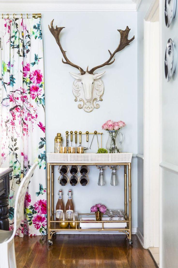 gold bar cart || floral curtains