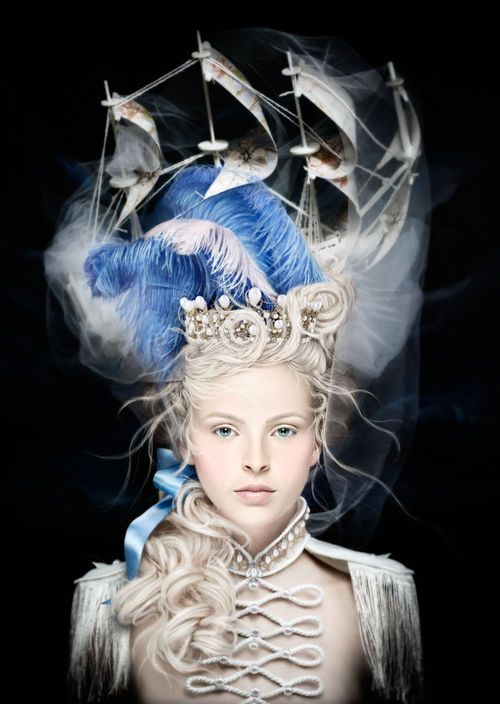 La Belle Poule, photographed by Alexia Sinclair, 2013  Over the course of a week, the artist hand constructed everything in this shot, from the headpiece and costume to the background, an oil painting of a tempestuous skyline. How did she capture the wispiness of the sea? It's not a composite, the model was simply photographed in front of the oil painted background.