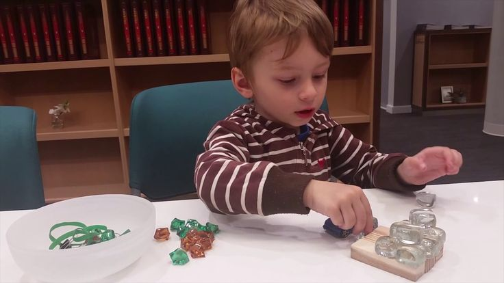 Multicolored glass pebbles develop motor skills and mindfulness