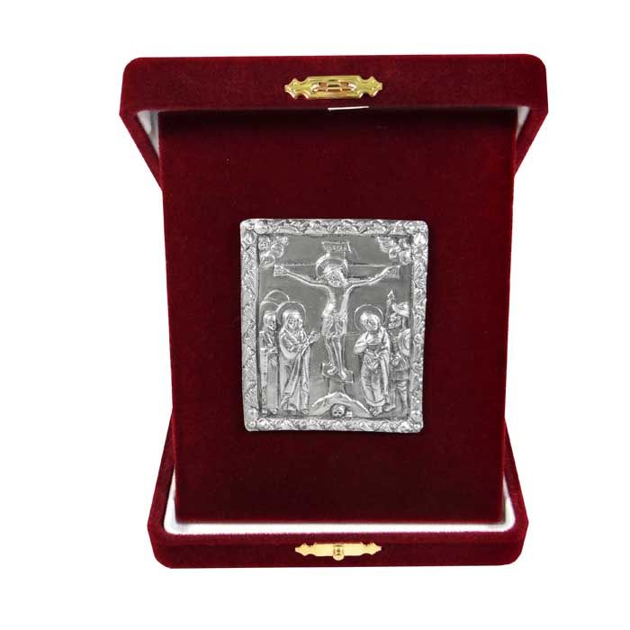 "Icon of the Crucifixion from the cover of a gospel made of silver with local gold plating with central representation of the ""Descent into Hades"", dating around 1693. On the reverse, Saint Sava is depicted with scenes from his life and the Annunciation.  The copy is made of pure silver 999° and place into a burgundy velver case. An exclusive gift that will be valued. Dimensions icon: 6 cm x 5 cm x 3 cm Dimensions with velvet case: 10,5 cm x 13 cm x 3 cm"