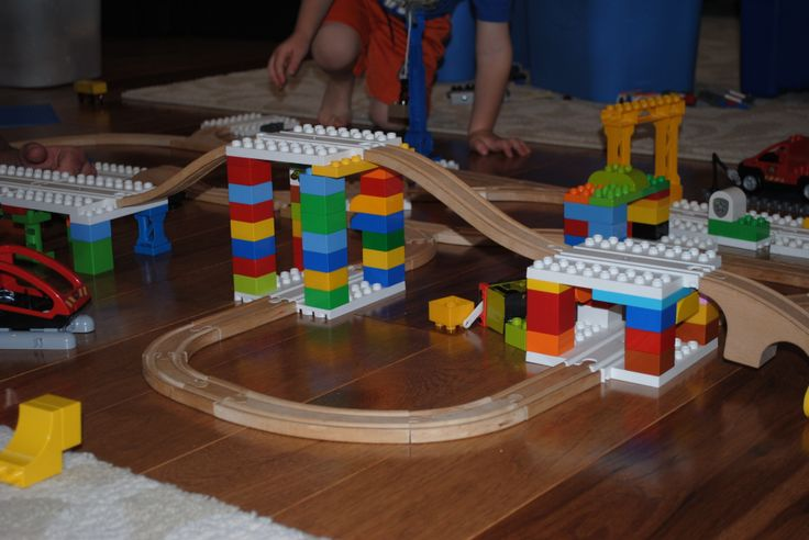 A cool multi-level wooden train track with Dreamup Toys block platforms supported by Duplos and Legos!  http://bit.ly/1yqTYsk