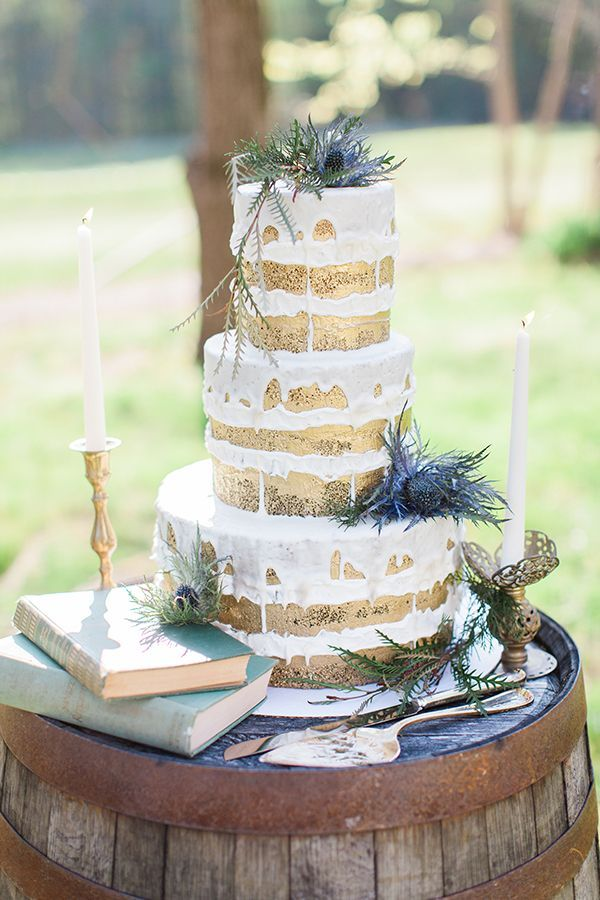 Rustic met refined in Bowtie Bakery's gold-brushed cake, which was lightly adorned with blue thistles and displayed on an old whiskey barrel. | Photo by Elizabeth Marie Photos
