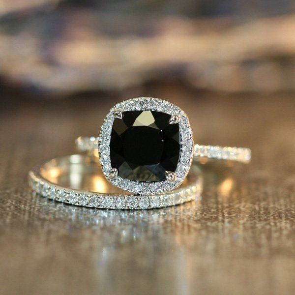 modern engagement ring with black diamond