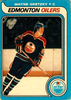The Wayne Gretzky Rookie Card shows Wayne as the Captain of the Edmonton Oilers of the NHL in the 1979 - 1980 season, in which he tallied an astonishing 51 goals and 86 assists for a total 137 points in 79 games (1.734 points per game average). That is why he is the Great One.