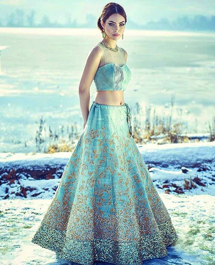 This indian wedding lehenga in aqua makes for a great sangeet outfit; Love the blouse!