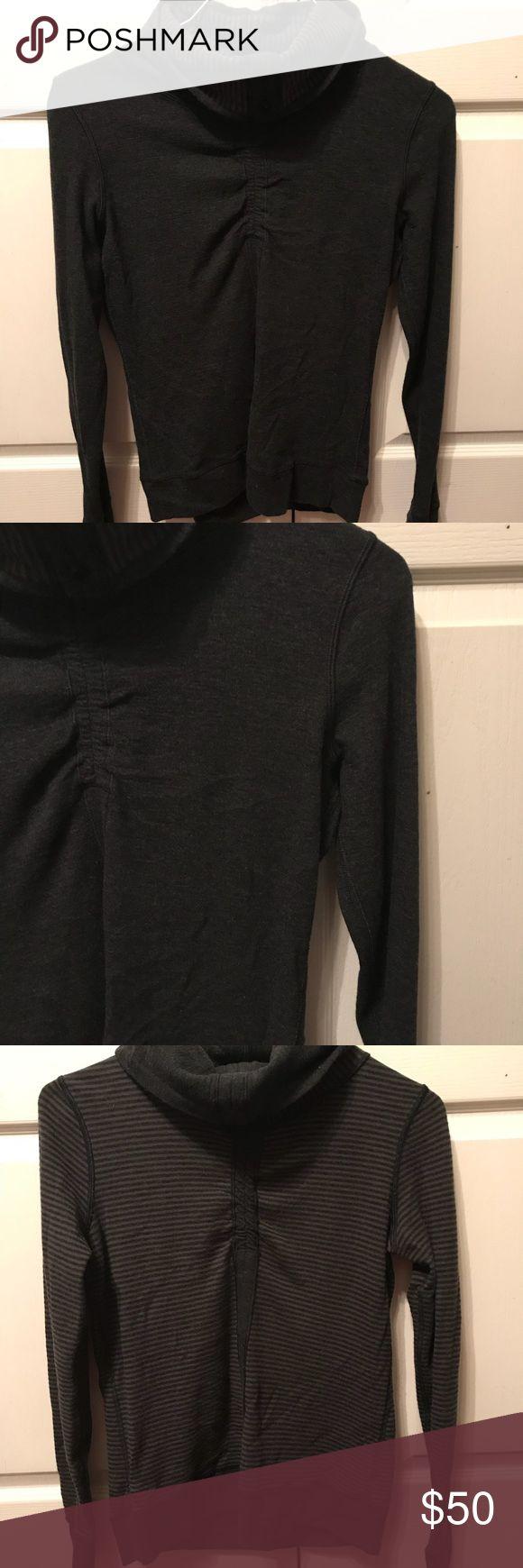 Lululemon reversible sweatshirt. Comfy, fitted reversible sweatshirt with thumb holes. Great for your early morning runs! Good condition. lululemon athletica Tops Sweatshirts & Hoodies