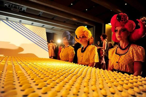 Nataional Gallery of Australia holds the Roy Lichtenstein Pop Remix opening night party.  Performance Art: Seeing Dots Penelope Benton and Alexandra Clapham  Performance installation Non-structural pine, MDF, stickers, lollies  Wigs designed and created by Jasmina Black  Performers Penelope Benton, Jasmina Black and Marni Jackson.  Photo: Lyn Mills - Canberra Times #art #lichtenstein #party #popart