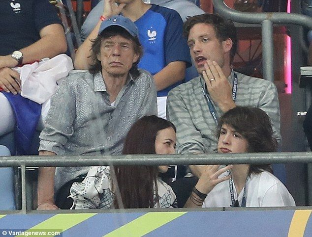 Sir Mick Jagger and his lookalike son Lucas join the rocker's other children Lizzie and James as they watch Portugal claim victory in EURO 2016 Final - 10.07.2016 http://www.dailymail.co.uk/tvshowbiz/article-3684670/Sir-Mick-Jagger-lookalike-son-Lucas-join-rocker-s-children-Lizzie-James-watch-Cristiano-Ronaldo-s-Portugal-claim-victory-EURO-2016-Final.html