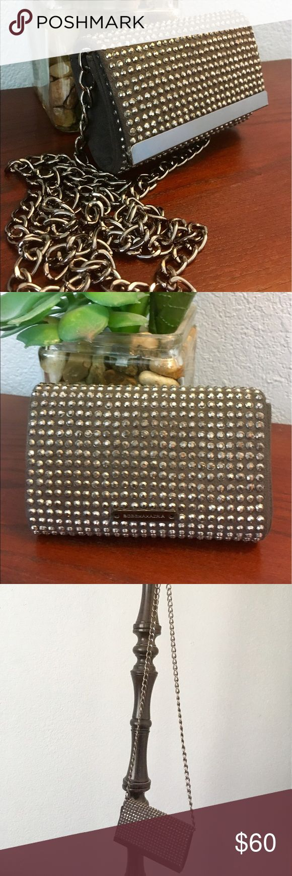 BCBG grey studded clutch with chain Studded grey and gunmetal BCBG clutch. Never worn and in great condition. Comes with a chain to wear cross body or over the shoulder but is not detachable. It can be tucked into the clutch easily. BCBGMaxAzria Bags Clutches & Wristlets