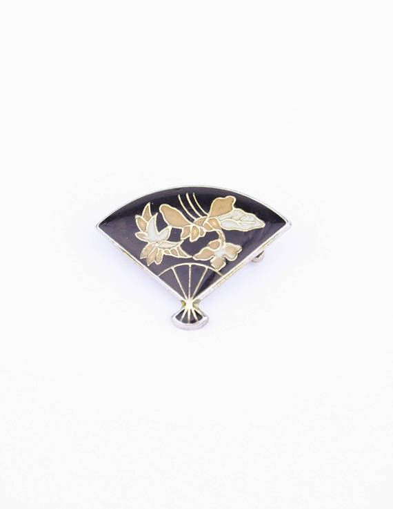 Check out this item in my Etsy shop https://www.etsy.com/ca/listing/546998258/80s-cloissine-fan-pin-japanese-style