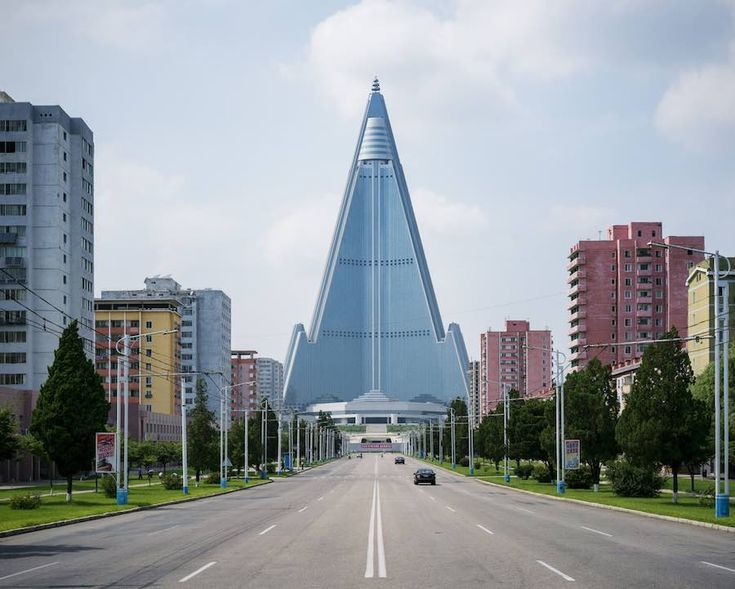 Raphael Olivier portrays Pyongyang austere architecture conveying a brutalist sense of leadership weaved into the urban fabric of the North Korean capital