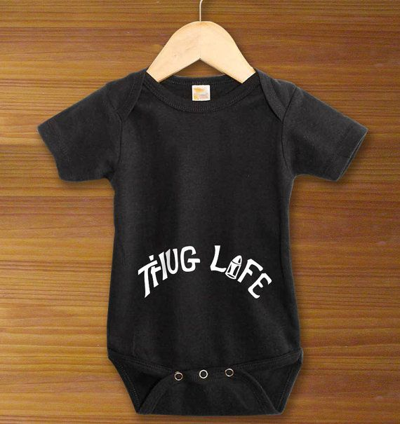 Not even crawling yet, and already your baby is living the thug life. Let him show off his swagger in this Thug Life Tattoo One Piece Bodysuit Shirt,