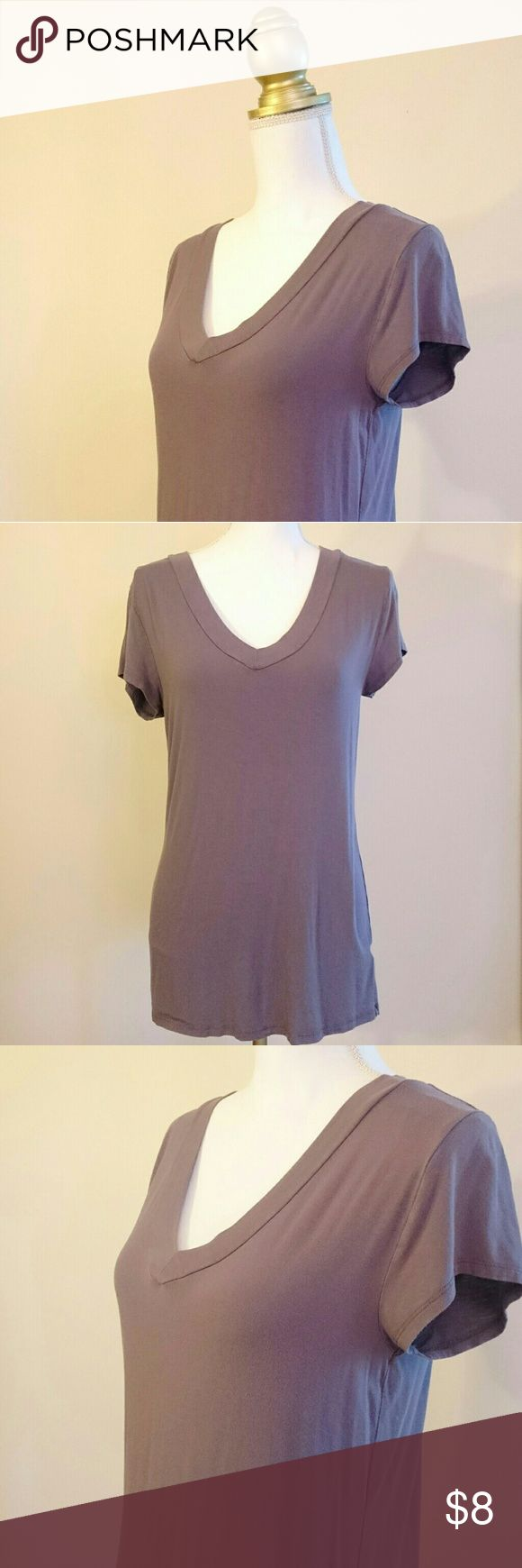 Gray v-neck Mossimo tee, super soft and very comfy My fav v-neck. I liked it so much that I accidentally bought it twice...so I have spare to sell to you. What's so great about it? Fabric is super soft and lightweight, but not seethrough thin like some. The color is a really pretty mocha, warm grayish color, a really good basic neutral shade. It does not have a pointless, tiny pocket on the front. Good thrown on and run out the door shirt. Fabric content: 95% rayon, 5% spandex. Mossimo…