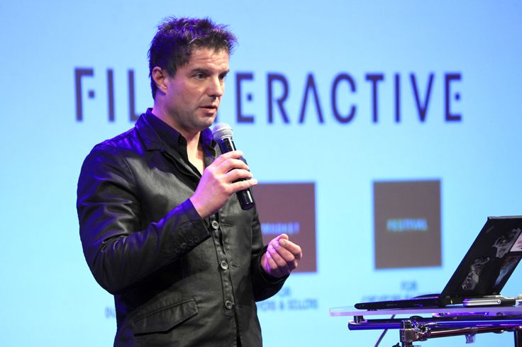 """Our keynote speaker Bernhard Hafenscher from Red Bull Media House presenting """"Beyond branded content - how Red Bull Media House developed a 360° approach as a global content production."""""""