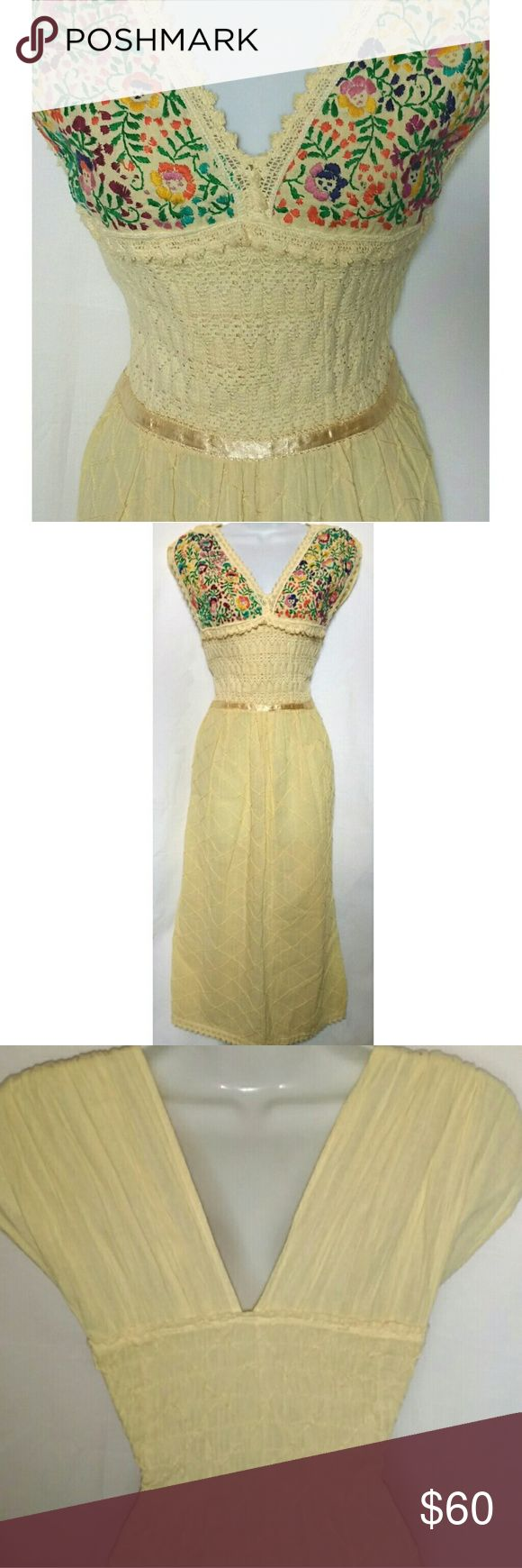 """Vintage Embroidered Sundress Perfect summer festival dress! 100% cotton. Hand stitched rainbow floral pattern on bodice. Crochet design at waist and lace trim. V cut at neck and back. The back has elastic ruching so it's easy to slip on and off. Skirt is slightly see through so I'd recommend wearing a slip or nude leggings underneath. There are so many lovely little details in this piece. Excellent condition, no flaws.  Measurements lying flat- 46"""" long shoulder to bottom hem 15.5"""" armpit to…"""