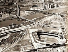 two classic old gentlemen; yankee stadium in the foreground with the polo grounds in the distance across the river: could a new york baseball fan have it any better?