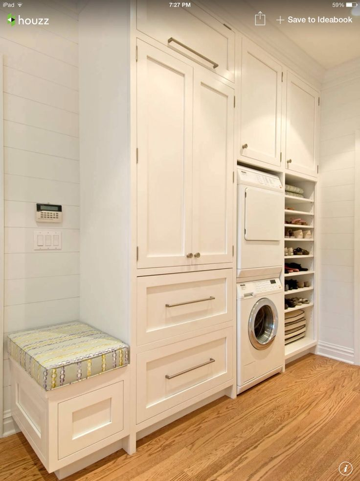 Stacked washer dryer with storage laundry closet for Small laundry design